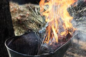 Dried palms being burned for Ash Wednesday ashes.