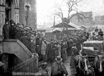 Step One: Obtain a miner's license. Not anyone could dig for gold. You needed to have a permit. This picture shows a long line-up of hopeful prospectors waiting to buy a licence from a Custom House in Victoria, British Columbia.