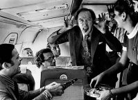 """Pierre Trudeau sticks his tongue out to Canadian Press Photographer Peter Bregg during the 1972 election campaign. This photo was taken aboard the campaign plane where such antics were considered off the record. The photo was not made available until after the death of the prime minister."" - Huffington Post."