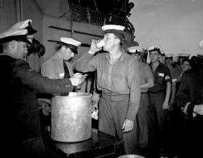 "This guy knows how to celebrate. Canadian sailors aboard the HMCS Prince Robert lined up to ""splice the mainbrace"" (ordered to drink) in celebration of VJ-Day."