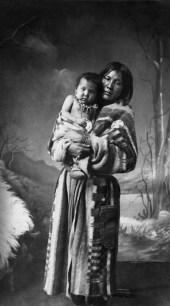 Katie, Sarcee (Tsuu T'ina) woman, and baby, Calgary, Alberta. (A. Ross, 1886)