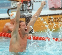 Mark Tewksbury celebrates his gold medal win in the 100m backstroke at the 1992 Barcelona Games.