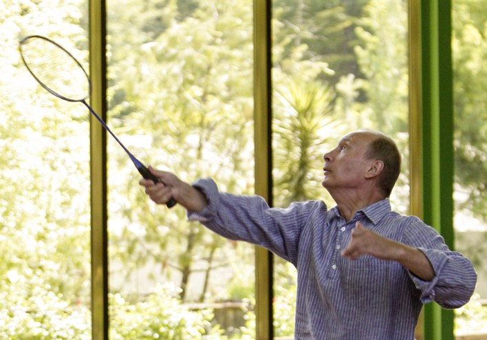 Russia's Prime Minister Vladimir Putin plays badminton with President Dmitry Medvedev during their meeting in the official vacation residence of Bocharov Ruchei in the Black Sea resort of Sochi, August 14, 2009