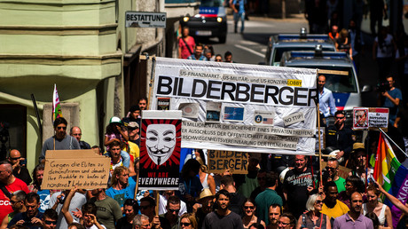 FILE PHOTO: Protesters take part in a demonstration against the Bilderberg conference in Telfs, Austria. © Christian Bruna