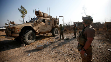 US military vehicles are seen in the town of Bashiqa, Iraq, during an operation to attack Islamic State militants in Mosul on November 7, 2016. © Azad Lashkari