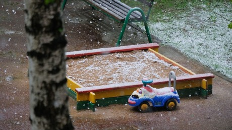 Children's playground on a Moscow street during a snowfall © Natalia Seliverstova