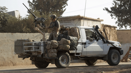 US soldiers ride a military vehicle in al-Kherbeh village, northern Aleppo province, Syria October 24, 2016 © Khalil Ashawi