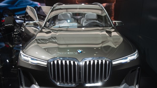 Image result for Nigerian man buried father with BMW