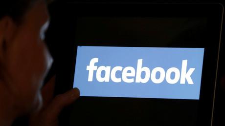 © Regis Duvignau  Facebook was tagging some users as 'interested in treason' – guess who media said would misuse data? — RT World News 5b14ea62dda4c8761d8b45e4