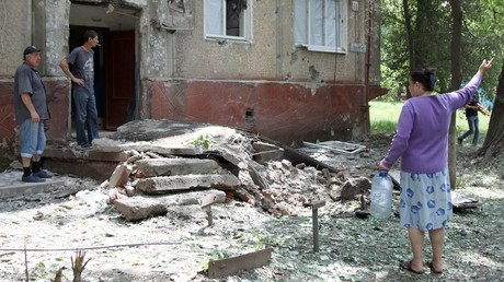 Residents in the courtyard of a residential building hit by shelling in the village of Gorlovka, Donetsk Region © Sergey Averin