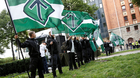 Nordic Resistance Movement members at a demonstration in Stockholm, Sweden on August 25, 2018. © TT News Agency / Pontus Lundahl
