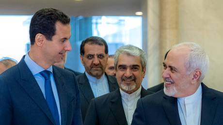 5cb65cbafc7e9341118b462f Syria & Iran slam US 'economic terrorism,' urge diplomacy
