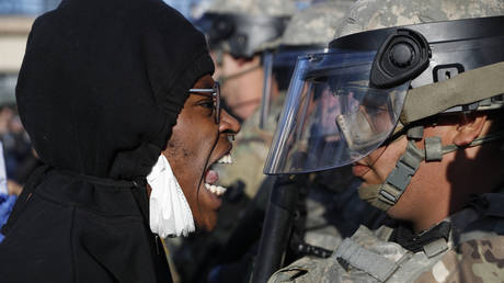 A protester yells at a member of the Minnesota National Guard on Friday. © AP Photo/John Minchillo