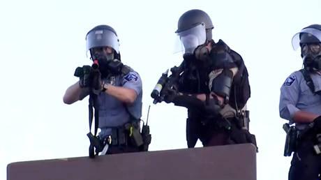 Police aim at Reuters TV cameraman during unrest in Minneapolis. © Reuters / Julio Cesar-Chavez
