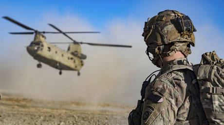 FILE PHOTO: U.S. Army Staff Sgt. Jason N. Bobo watches as a CH-47 Chinook helicopter prepares to land. December, 29, 2019 in Southeastern Afghanistan