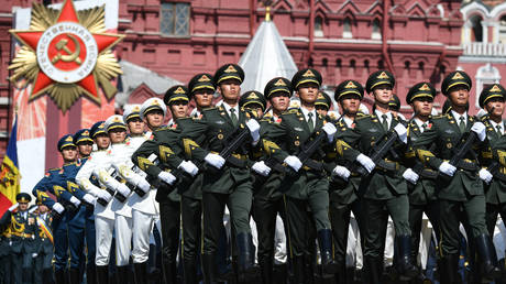 Soldiers of China's People's Liberation Army take part in the Victory Day Parade in Red Square in Moscow, Russia, June 24, 2020.