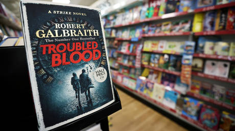 "JK Rowling's latest book ""Troubled Blood"", written under pseudonym Robert Galbraith, is pictured at a bookstore in Hanley, Stoke-on-Trent, Britain, September 15, 2020."