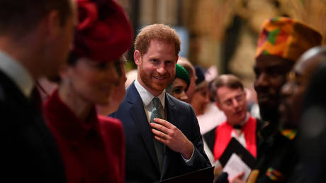 FILE PHOTO: Prince Harry is introduced to performers as he leaves after attending the annual Commonwealth Service at Westminster Abbey in London, Britain March 9, 2020