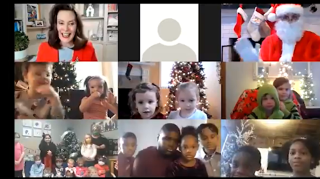 A screenshot shows Michigan Governor Gretchen Whitmer's Zoom call with children and Santa Claus.