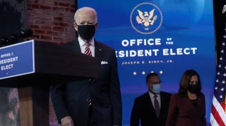 U.S. President-elect Joe Biden enters the room followed by Vice President- elect Kamala Harris and their nominee for secretary of education, Miguel Cardona in Wilmington, Delaware, U.S., December 23, 2020.