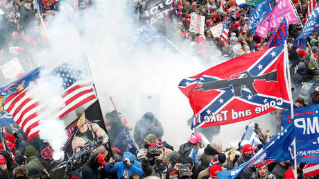 FILE PHOTO: Tear gas is released into a crowd of protesters during clashes with Capitol police at a rally to contest the certification of the 2020 US presidential election results by the US Congress, at the US Capitol Building in Washington, U.S, January 6, 2021