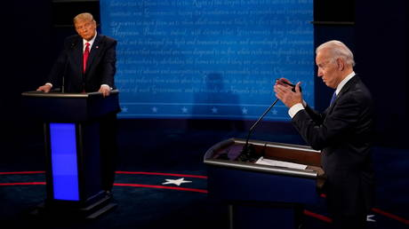 Joe Biden and Donald Trump during a presidential election debate in Nashville, Tennessee, October 2020. © Morry Gash / Reuters