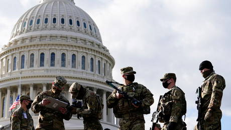National Guard troops receive guns and ammunition outside the U.S. Capitol building