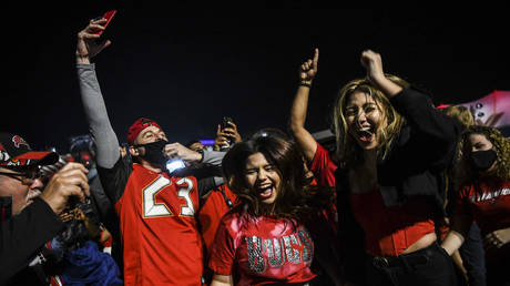 FILE PHOTO. Tampa Bay Buccaneers fans celebrate their victory in Tampa, Florida. ©CHANDAN KHANNA / AFP