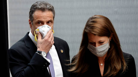 FILE PHOTO: New York Governor Andrew Cuomo and Secretary to the Governor Melissa DeRosa arrive for a daily coronavirus briefing at New York Medical College in Valhalla, New York.