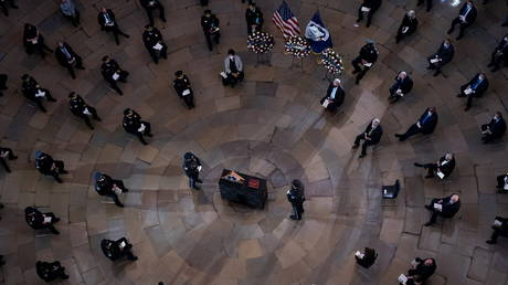 A memorial service is held for officer Brian Sicknick on February 3 in the US Capitol Rotunda.