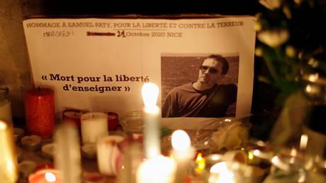 A makeshift memorial to murdered teacher Samuel Paty in Nice, France, October 2020. © Eric Gaillard / Reuters