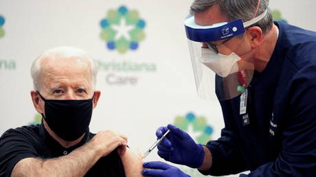 U.S. President-elect Joe Biden receives his second dose of a Covid-19 vaccine at ChristianaCare Christiana Hospital in Newark, Delaware, US, January 11, 2021.