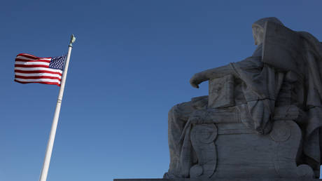 A sculpture called the Contemplation of Justice on the US Supreme Court building,  July 2, 2020 file photo.