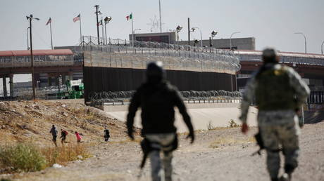 Migrants run away from Mexican National Guard to turn themselves in to US Border Patrol agents to request for asylum in El Paso, Texas, February 9, 2021