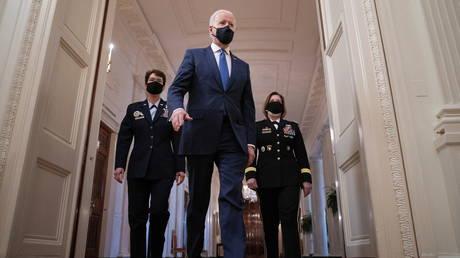 President Joe Biden walks ahead of USAF General Jacqueline Van Ovost and Army Lt-Gen. Laura J. Richardson, March 8, 2021.