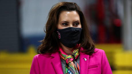 Michigan Governor Gretchen Whitmer is shown visiting a Pfizer plant last month in Kalamazoo, Michigan.