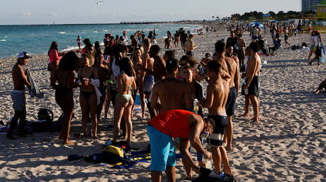 FILE PHOHO: Revelers flock to the beach to celebrate spring break, amid the Covid-19 outbreak, in Miami Beach, Florida, US, March 5, 2021