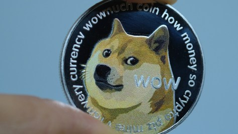 Dogecoin plunges after meme-inspired crypto frenzy pushed its market value higher than Twitter