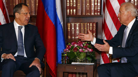 FILE PHOTO. Russia's Foreign Minister Sergey Lavrov meets then-US Vice-President Joe Biden in February 2013.