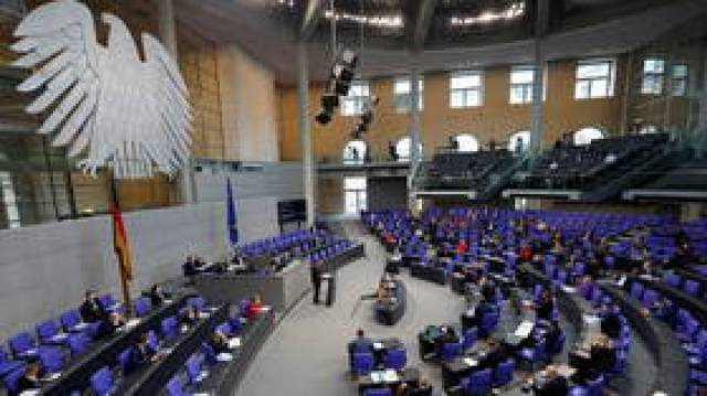 'As sorry as we are': German lawmakers approve new controversial Covid-19 lockdown bill following heated debate