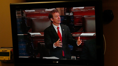 U.S. Senator Rand Paul appears on a television screen as he filibusters on the Senate floor in opposition to the nomination of John Brennan to lead the CIA, in Washington, March 6, 2013 (Reuters / Jonathan Ernst)