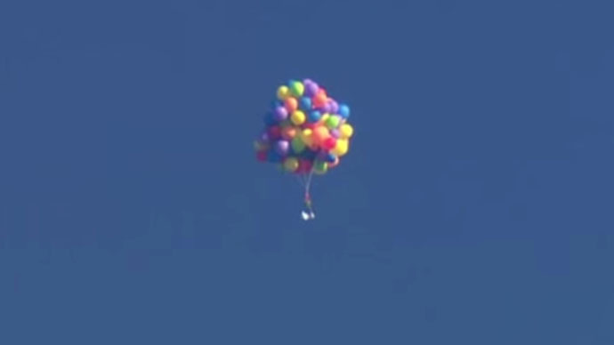 chair with balloons dining set of 2 up canadian lifted into sky in lawn by 100