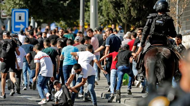 Israeli security forces disperse Palestinians near the Damascus gate in east Jerusalem, on June 15, 2021, ahead of the March of the Flags which marks the anniversary of Israel's 1967 occupation of the city's eastern sector.