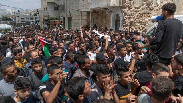 Palestinian mourners chant anti-Israel slogans during the funeral of Ahmad Shamsa, 15, in the occupied West Bank village of Beta, near Nablus, Thursday, June. 17, 2021.