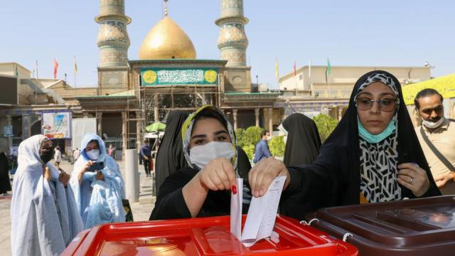 Iranian women cast their vote during presidential elections at a polling station in Tehran, Iran June 18, 2021.