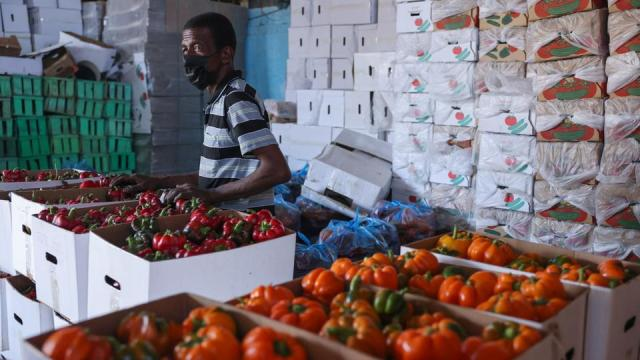 A worker prepares crates of freshly-picked bell peppers in a warehouse in the Palestinian city of Rafah in southern Gaza, on June 21, 2021, to be exported the following day through the Karm Abu Salem crossing.
