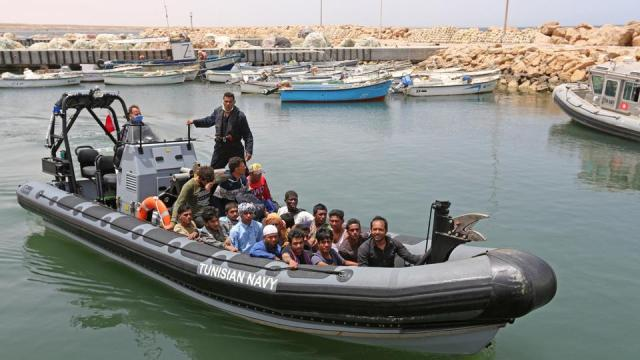 Migrants rescued by Tunisia's national guard during an attempted crossing of the Mediterranean by boat arrive at the port of el Ketef in Ben Guerdane in southern Tunisia near the border with Libya on June 27, 2021.