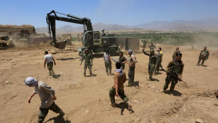 Afghan soldiers rebuild a checkpoint recaptured from Taliban, in Alishing district of Laghman province, Afghanistan on July 8, 2021.