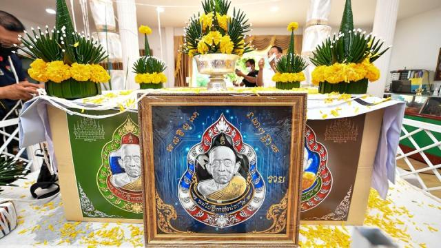 This handout courtesy of CryptoAmulets founder Ekkaphong Khemthong taken on June 9, 2021 and released on June 22, 2021 shows replicas of the digital amulets bearing an image of the face of Buddhist abbot Luang Pu Heng being displayed during a blessing ceremony at the Wat Pattana Thammaram temple in Surin.