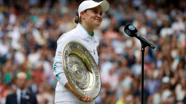 Australia's Ashleigh Barty holds her trophy after defeating Czech Republic's Karolina Pliskova on the twelfth day of the 2021 Wimbledon Championships in London, on July 10, 2021.